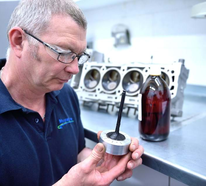 Millbrook engineer conducting fuel testing in fuels and lubricants test laboratory