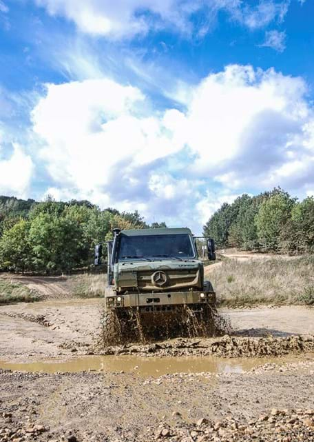 Military vehicle testing on the off-road tracks wading pond at Millbrook Proving Ground