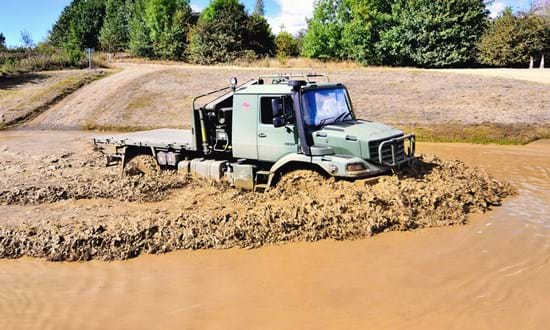 Military vehicle in a water trough on off-road test track at Millbrook DVD