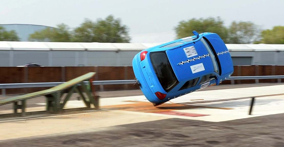 Car rollover crash test at Millbrook against FMVSS 208 test procedure