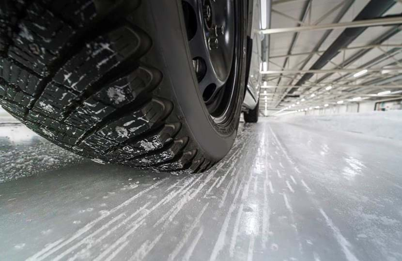 Closeup of ice braking winter tyre test